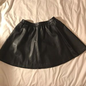 Divided black faux leather circle mini skirt